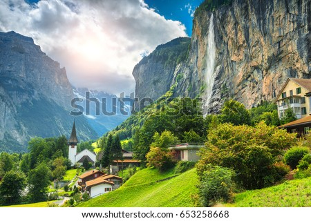 Amazing touristic alpine village with famous church and Staubbach waterfall, Lauterbrunnen, Switzerland, Europe #653258668