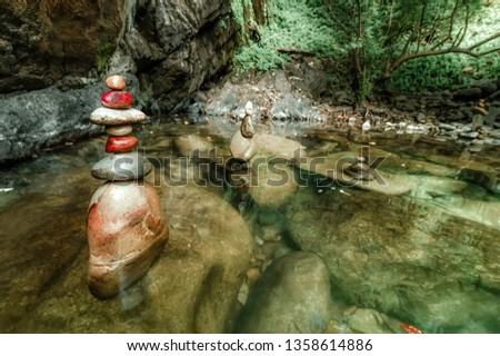 Amazing tropical rain forest landscape with lake tranquil water and balancing rocks tower for zen meditation practice.   Calmness concept. Nature background #1358614886