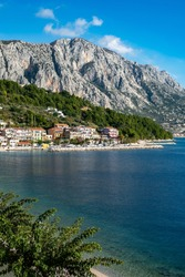 Amazing view at Makarska rivera beaches with apartments in Makarska Riviera. Podgora-Caklje area with high mountain Biokovo in background. Croatia, Dalmatia