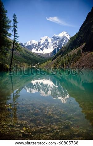Amazing view at the mountain lake - stock photo