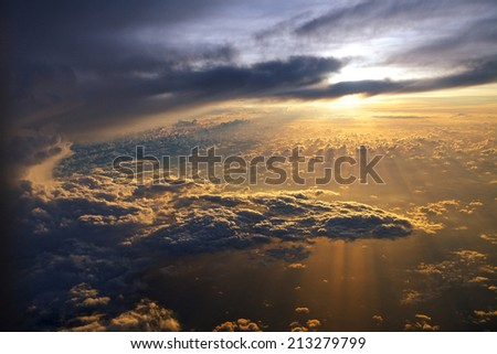 Stock Photo Amazing view from plane on sunrise sun and clouds