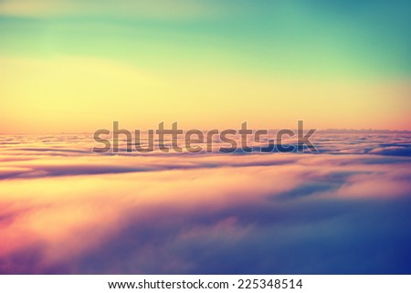 Stock Photo Amazing view from plane on the orange sky, sunset sun and clouds. Instagram- like filter