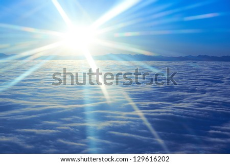 Amazing view from plane on the sky, sunset sun and clouds