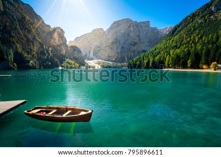 amazing view of braies lake with wooden boats on the water, surrounded by dolomites mountains. Trentino alto adige, Italy on the water, surrounded by dolomites mountains. Trentino alto adige, Italy
