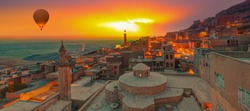 Amazing view of Mardin castle in old town on the background spectacular Mesopotamia at sunset - Mardin, Turkey