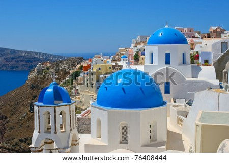 Amazing view of Oia on island of Santorini in Greece. Traditional architecture with famous blue churches.