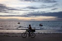 Amazing view of Porto de Galinha (Chickens Port) Beach in Pernambuco State, Northeast area of Brazil. Beautiful sunny day, blue sky. Bike silhouette