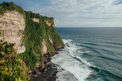 Amazing view of steep cliff and ocean view from Uluwatu temple in Bali island.The cliff-fringed coastline overlooking the Indian ocean.