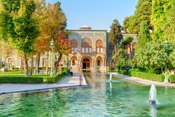 Amazing view of the Golestan Palace and beautiful fountains among green gardens in Tehran, Iran. The Golestan Palace is a popular tourist attraction of the Middle East. Traditional Persian exterior.