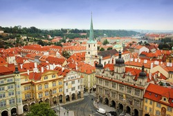 Amazing view of the roofs of buildings and Church of St. Thomas in Prague from the top of St Nicholas Bell Tower