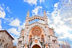 Amazing view of the Sant Bartomeu Church in spanish Soller, Mallorca, Balearic Islands, taken against the sun in January during winter season. The beautiful city is a popular tourist destination.