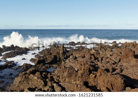 Amazing view of the sea waves on the coast of the island on a summer day. Seaside resort.