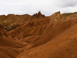 amazing view of the Skazka canyon in Kyrgyzstan on the shore of the high mountain lake Issyk Kul