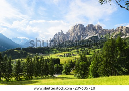 Stock Photo Amazing view on Cristallo Mountains with  alpine village on sunny summer day, , The Dolomites Mountains, Italy