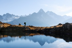 Amazing view on Monte Bianco mountains range with tourist on a background. Lac de Cheserys lake, Chamonix, Graian Alps. Landscape photography