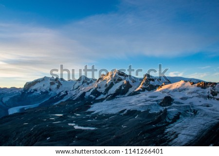 Amazing view on Pennine Alps range from Matterhorn in Swiss Alps at sunrise, most famous mountain in Europe.  Best place for active life, hiking, trekking and climbing in Switzerland.