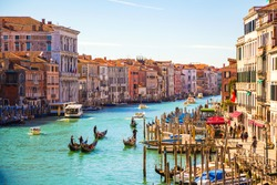 Amazing view on the beautiful Venice, Italy. Many gondolas sailing down one of the canals.