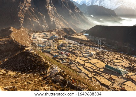 Amazing view over mountain village Thame in Sagarmatha national park, Himalayas, Nepal. Idyllic asian village in mountain gorge. Sunrise scenery of Thame on a beautiful morning.