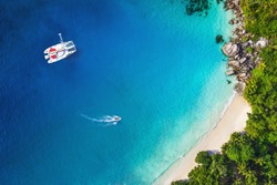 Amazing view to Yacht in bay with beach - Drone view. Birds eye angle