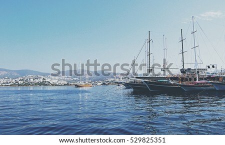 Amazing vintage. Beautiful seascape. Boats on a background of blue sea. Seascape. Sweet memories. Travel and vacation. Marine style. Stunning view. Wonderful landscape. Amazing places. Matte tone