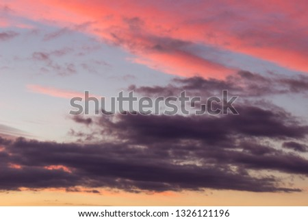 Amazing vivid colors of a sunlit, contrasty clouds on a sunset sky #1326121196