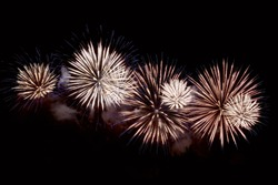 Amazing white and blue fireworks on dark background. Flashes of fireworks of green color