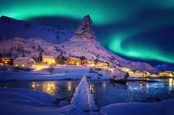 Amazing wintry landscape of Lofoten. Fantastic Winter seascape during sunset. majestic mountains with northern lights. picturesque nature scenery. creative image. Nature background. Traveling concept