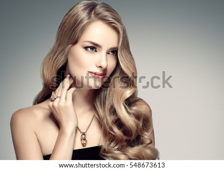 Amazing woman portrait. Beautiful girl with long wavy hair. Blonde model with hairstyle #548673613
