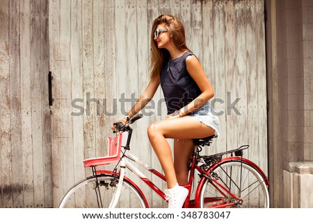 amazing  woman ride bicycle and wear boho chic outfit,denim clothes,hipster girl,sunglasses fashion,urban street style,soft vintage colors,rider retro bicycle.music lounge,relax