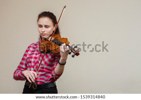 Amazing young brunette looking at notes, learning classical work. Portrait.