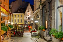amazingly beautiful street in Tallinn's old town. Interesting street which is beside the town hall square. Historical landmark in Estonia. The medieval architecture. The summer season.Night.