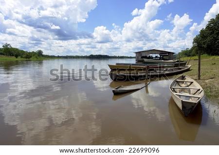 Amazon river native community boat pear