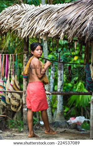 AMAZONIA, PERU - NOV 10, 2010: Unidentified Amazonian girl sells beads. Indigenous people of Amazonia are protected by COICA (Coordinator of Indigenous Organizations of the Amazon River Basin)