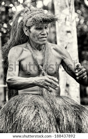 AMAZONIA, PERU - NOV 10, 2010: Unidentified Amazonian indigenous man. Indigenous people of Amazonia are protected by  COICA (Coordinator of Indigenous Organizations of the Amazon River Basin)