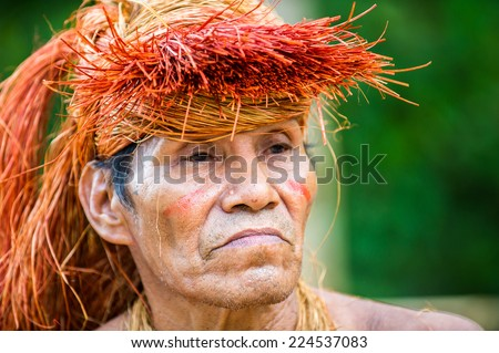 AMAZONIA PERU NOV 10 2010 Unidentified Amazonian indigenous man portrait Indigenous people of Amazonia are protected by COICA Coordinator of Indigenous Organizations of the Amazon River Basin