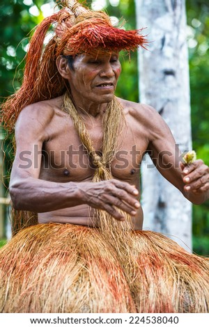 AMAZONIA, PERU - NOV 10, 2010: Unidentified Amazonian indigenous man portrait. Indigenous people of Amazonia are protected by  COICA (Coordinator of Indigenous Organizations of the Amazon River Basin)
