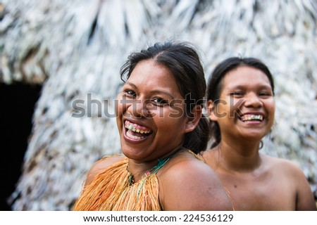 AMAZONIA, PERU - NOV 10, 2010: Unidentified Amazonian indigenous two women laugh.Indigenous people of Amazonia are protected byCOICA (Coordinator of Indigenous Organizations of the Amazon River Basin)