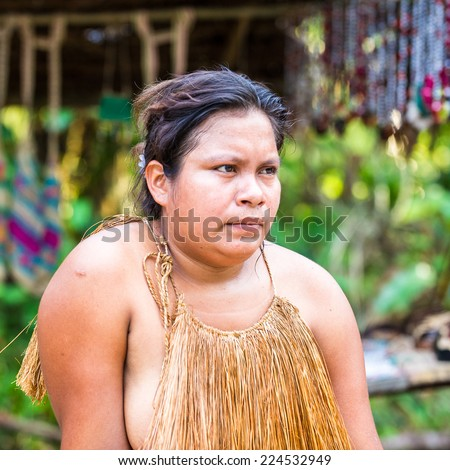 AMAZONIA, PERU - NOV 10, 2010: Unidentified Amazonian indigenous woman. Indigenous people of Amazonia are protected by  COICA (Coordinator of Indigenous Organizations of the Amazon River Basin)