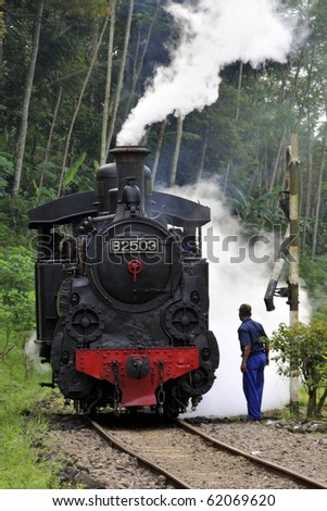 AMBARAWA, INDONESIA - JUNE 18: The only operating B2503 Steam Engine in the world was being prepared to take a group of enthusiasts to the village of Bedono. June 18, 2010 in Ambarawa, Indonesia.