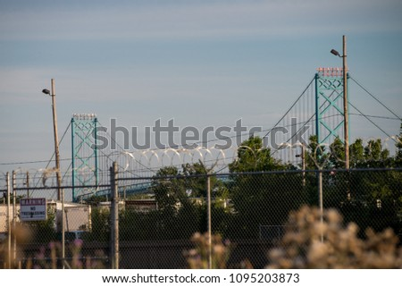 Ambassador bridge between Detroit and Windsor border #1095203873