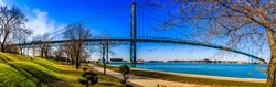 Ambassador Bridge, border between Canada and US. A view at Riverfront, Windsor, Ontario, Canada. Beautiful walking area with a nice look to Detroit city, US.