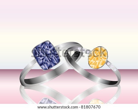 Amber and Sapphire platinum and silver rings with reflection