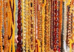 Amber background of beads. Amber beads in a jewelry shop window. Jewelry design.
