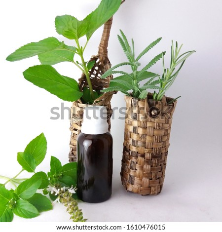 Amber bottle and aromatic herbs