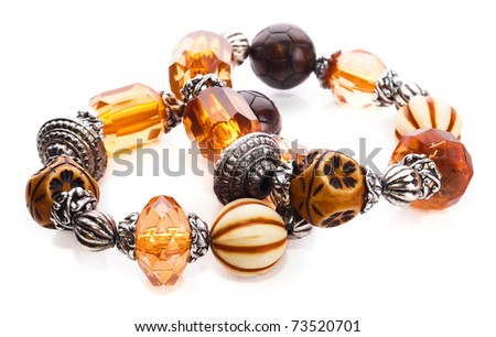 Amber bracelet with semiprecious stones and glass beads silver on a white insulated background