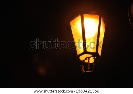 Amber glow from street lamp. Extremely aesthetic. Mysterious, foreshadowing and dangerous feeling but also warm, giving a sense of home and safety. Extreme contrast #1363421366
