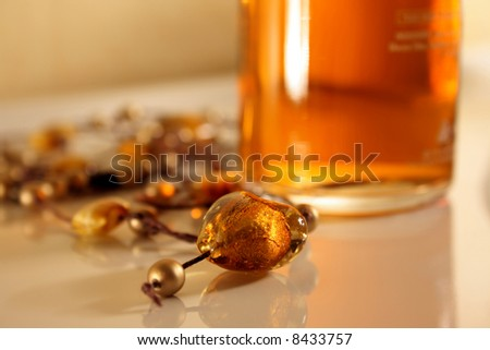 Amber heart on necklace with golden pearls - stock photo