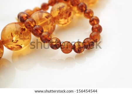 Amber Jewelry with soft reflection and copy space