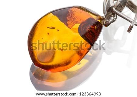 Amber pendant isolated on white background