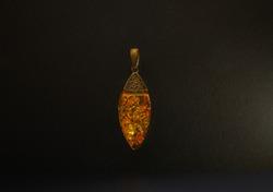 Amber Pendant on black background, exquisite Baltic amber, Latvia, black